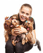 Cute young girl holding Yorkshire terrier dogs on her lap